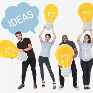 Diverse people with new ideas and bright light bulbs